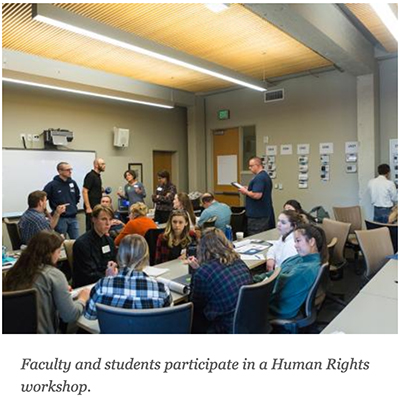 Faculty and students participate in a Human Rights workshop.